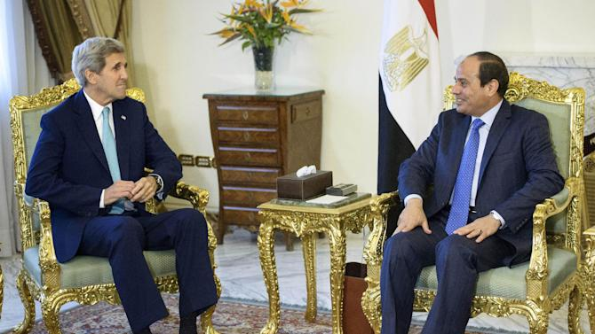Egypt's President Abdel-Fattah el-Sissi, right, and U.S. Secretary of State John Kerry sit for photos before their meeting at the presidential palace in Cairo, Egypt, Sunday, Aug. 2, 2015. Despite persistent human rights concerns, the United States on Sunday resumed formal security talks with Egypt that were last held six years ago and kept on hiatus until now amid the political unrest that swept the country in the wake of the Arab Spring. (Brendan Smialowski/Pool Photo via AP)