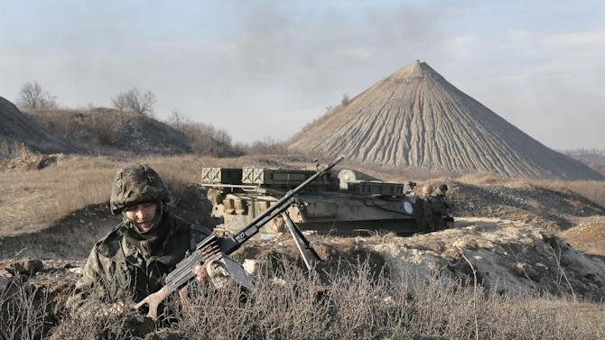 "FILE - In this March 11, 2015, file photo, a Ukrainian serviceman takes position at the front line outside Kurahovo, in the Donetsk region of Ukraine. The United States now sees the Ukrainian rebels as a Russian force. American officials briefed on intelligence from the region say Russia has significantly deepened its command and control of the militants in eastern Ukraine in recent months, leading the U.S. to quietly introduce a new term: ""combined Russian-separatist forces."" (AP Photo/Efrem Lukatsky, File)"