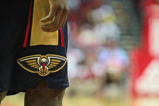The New Orleans Pelicans' new uniforms sport the Pelicans logo on the side of the shorts as seen during play against the Houston Rockets during the second half of a preseason NBA basketball game in Ho