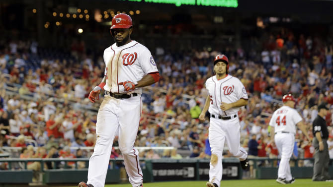 Washington Nationals' Denard Span and Anthony Rendon (6) score on Nationals' Adam LaRoche's two-RBI triple during the fourth inning of a baseball game against the Colorado Rockies at Nationals Park, Thursday, June 20, 2013, in Washington. (AP Photo/Alex Brandon)