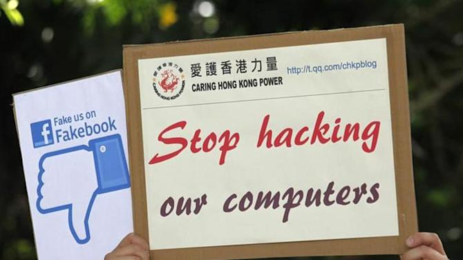 "A demonstrator from the pro-China ""Caring Hong Kong Power"" group protests over claims from former U.S. spy agency contractor Edward Snowden that the National Security Agency (NSA) hacked computers in the Chinese territory, outside the U.S. Consulate in Hong Kong July 9, 2013."