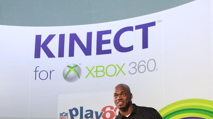 IMAGE DISTRIBUTED FOR XBOX - Young Gabriel Rico competes against NFL running back Adrian Peterson at Kinect for Xbox 360 on Thursday, Jan. 31, 2013 in New Orleans. (Photo by Barry Brecheisen/Invision for Xbox/AP Images)