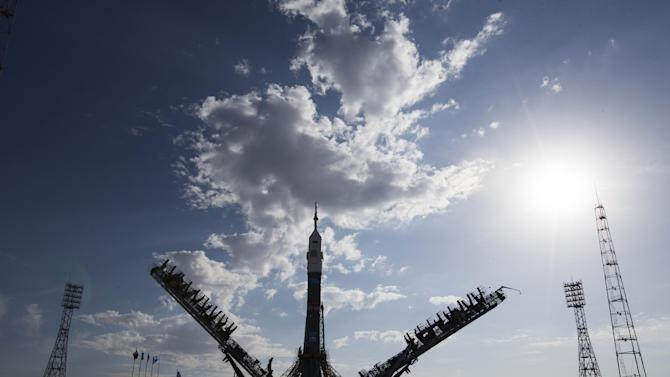 Service towers hold Russia's Soyuz-FG booster rocket with the space capsule Soyuz TMA-14M that will carry a new crew to the International Space Station (ISS) after being rolled out to the launch pad at the Russian leased Baikonur cosmodrome, the world's first and largest operational space launch facility, in Kazakhstan, Tuesday, Sept. 23, 2014. U.S. astronaut Barry Wilmore, and Russian cosmonauts Alexander Samokutyaev and Elena Serova are the next crew scheduled to travel to the International Space Station on Sep. 26. (AP Photo/Pavel Golovkin)