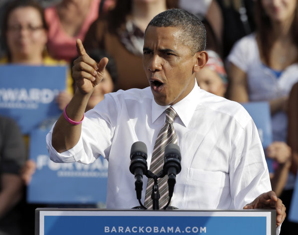 President Obama gestures while speaking at a campaign event at Ybor Centennial Park in Tampa, Fla., Thursday, Oct. 25, 2012. The president is on the second day of his 48 hour, 8 state campaign blitz. (AP Photo/Chris O&#39;Meara)
