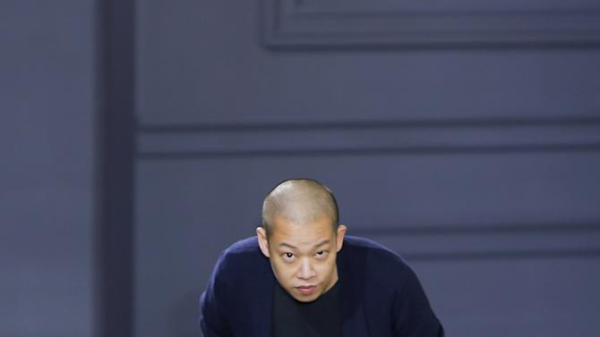 Designer Jason Wu greets guests after his show Fall/Winter 2016 collection during New York Fashion Week in New York