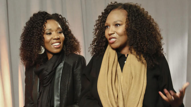 """In this Wednesday, Feb. 6, 2013 photo, Swati Dlamini, left, and Zaziwe Dlamini-Manaway, granddaughters of Nelson and Winnie Mandela, speak during an interview in New York.  The sisters are stars of  the new reality show """"Being Mandela,"""" produced by COZI TV for NBC.  The 30-minute weekly show premieres on Sunday, Feb. 10 at 9 PM ET and will follow the next generation of Mandela family through the experiences of sisters Zaziwe and Swati and their families.  (AP Photo/Bebeto Matthews)"""