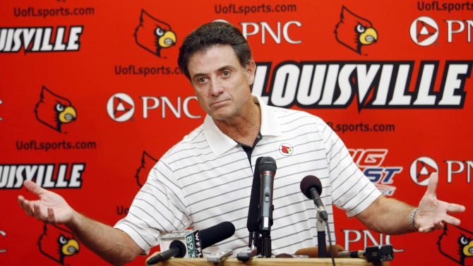 FILE - In this Aug. 26, 2009, file photo, Louisville basketball coach Rick Pitino makes a point during a news conference in Louisville, Ky. A person familiar with the situation says that the Atlantic Coast Conference's presidents and chancellors have voted unanimously to add Louisville as the replacement for Maryland.  The person says ACC leaders also considered Connecticut and Cincinnati over the past week before choosing to add the Cardinals from the Big East.  The person spoke to The Associated Press Wednesday morning, Nov. 28, 2012 on condition of anonymity because the ACC has not publicly discussed future expansion plans. (AP Photo/Ed Reinke, File)
