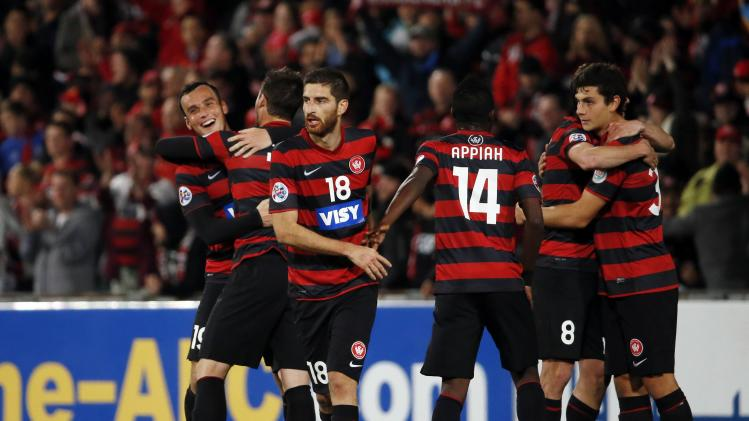 Western Sydney Wanderers' players celebrate after winning their AFC Champions League quarter-final soccer match against Guangzhou Evergrande in Sydney