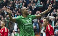 Werder Bremen&#39;s Brazilian centreback Naldo, seen here in April 2012, is due to sign for rival Bundesliga side Vfl Wolfsburg