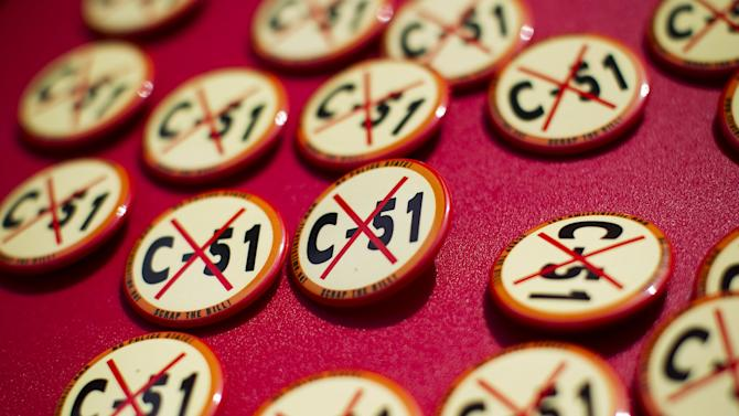 Pins are handed out during a rally against Bill C-51, the Canadian federal government's proposed anti-terrorism legislation in Vancouver.