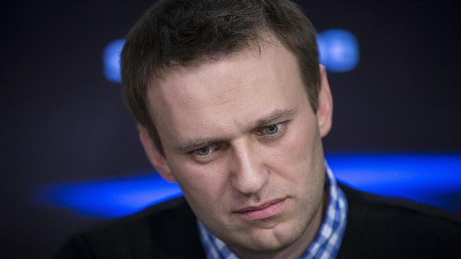 Russian opposition leader Alexey Navalny listens to a question during an interview at the Echo Moskvy (Echo of Moscow) radio station in Moscow,  Russia, Monday, April 8, 2013. Navalny made his name as an anti-corruption whistleblower and spearheaded massive anti-Kremlin protests that followed the rigged parliament election in Dec. 2011. (AP Photo/Alexander Zemlianichenko)
