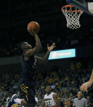 West Virginia beats Marshall 74-64