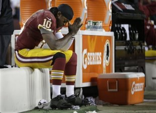 Robert Griffin III sits on the bench after being injured against the Seattle Seahawks. (AP)