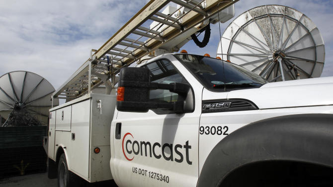 In this Thursday, April 25, 2013, photo, a Comcast truck is parked in Berlin, Vt. Comcast Corp. reports quarterly financial results before the market opens on Wednesday, May 1, 2013.  (AP Photo/Toby Talbot)