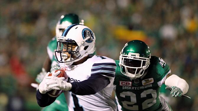 Toronto Argonauts Anthony Coombs gets hassled by Saskatchewan Roughriders Curtis Steele during CFL game in Regina