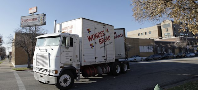 <p>               A Wonder Bread truck pulls out of the Utah Hostess plant in Ogden, Utah, Thursday, Nov. 15, 2012. Hostess Brands Inc. said it likely won't make an announcement until Friday morning on whether it will move to liquidate its business, after the company had set a Thursday deadline for striking employees to return to work. The maker of Twinkies, Ding Dongs and Wonder Bread said Thursday it will file a motion in U.S. Bankruptcy Court to shutter operations if enough workers don't return by 5 p.m. EST. That would result in the loss of about 18,000 jobs, including hundreds in Ogden. (AP Photo/Rick Bowmer)