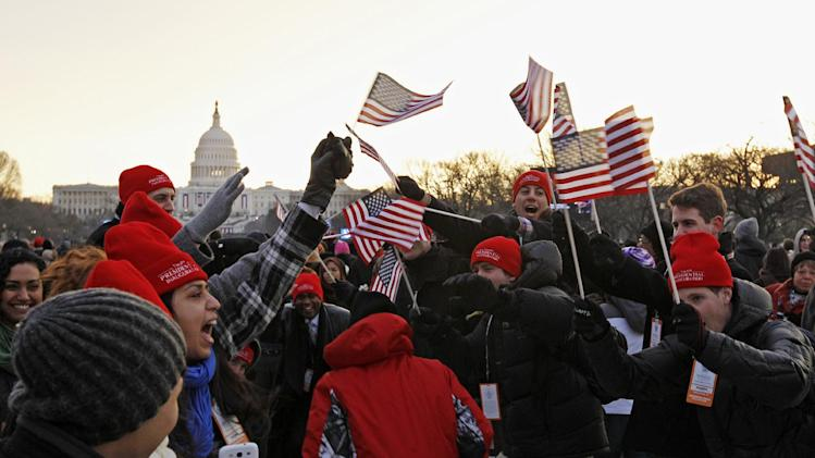 President Barack Obama supporters cheer on the National Mall in Washington, Monday, Jan. 21, 2013, prior to the start of President Barack Obama's ceremonial swearing-in ceremony during the 57th Presidential Inauguration. (AP Photo/Jose Luis Magana)
