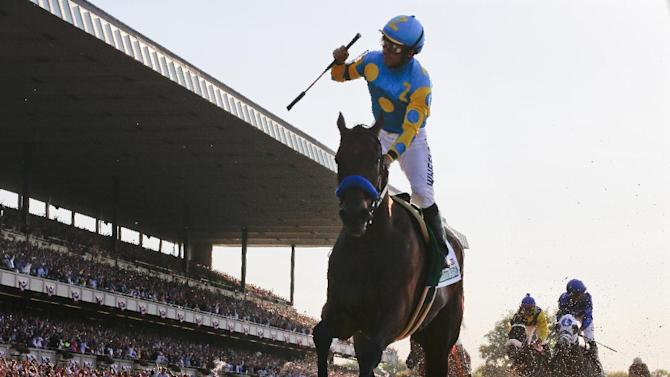 FILE - In this June 6, 2015, file photo, Victor Espinoza reacts after crossing the finish line with American Pharoah to win the Belmont Stakes horse race at Belmont Park in Elmont, N.Y. For the rest of his life, Espinoza will be introduced as a Triple Crown winner. He rode American Pharoah to wins in the Kentucky Derby, Preakness Stakes and Belmont Stakes. (AP Photo/Julio Cortez, File)