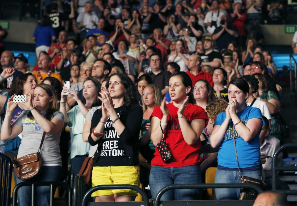 Concert goers attend the Boston Strong Concert: An Evening of Support and Celebration at the TD Garden on Thursday, May 30, 2013. (Photo by Bizuayehu Tesfaye/Invision/AP)