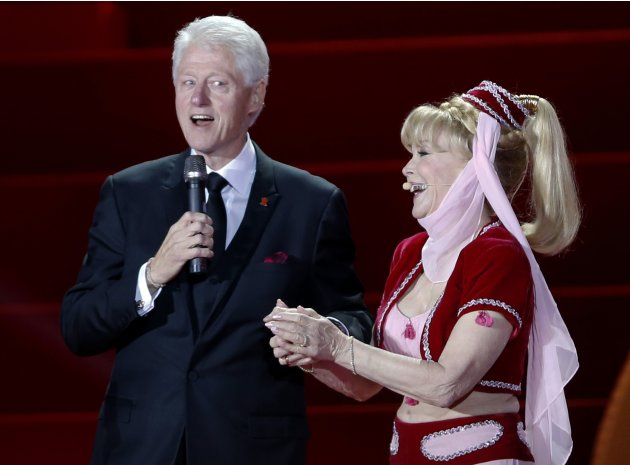 U.S. actress Eden listens to fomer U.S. President Clinton during the opening ceremony of the 21st Life Ball in Vienna