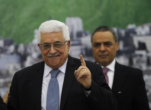 Palestinian President Abbas gestures during a PLO executive committee meeting in Ramallah