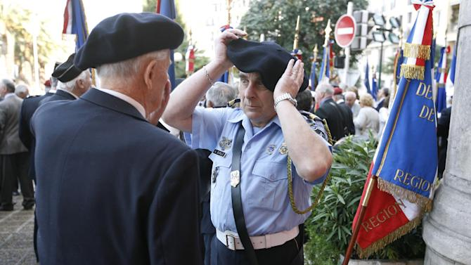 Veterans of World War II take part in a ceremony in Nice, southeastern France, Wednesday, May 8, 2013, marking the 68th anniversary of the end of World War II in Europe. (AP Photo/Lionel Cironneau)