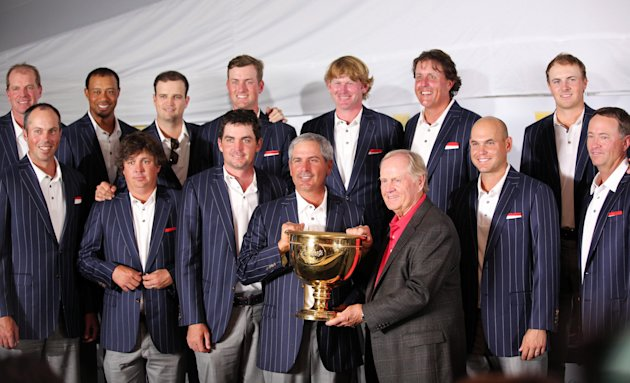 The USA Team poses with the Presidents Cup trophy after winning. (USA Today)