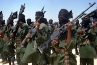 Islamist fighters loyal to Somalia''s Al-Qaida inspired al-Shebab group perform military drills in a village in Lower Shabelle region, some 25 kilometres outside Mogadishu on February 17, 2011