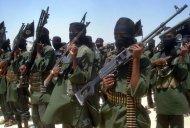 Islamist fighters loyal to Somalia''s Al-Qaida inspired al-Shebab group perform military drills in a village in Lower Shabelle region, some 25 kilometres outside Mogadishu on February 17, 2011