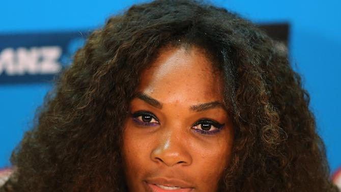 """FILE - In this Jan. 12, 2013 file photo, Serena Williams answers a question during a press conference ahead of  the Australian Open tennis championship in Melbourne, Australia. Williams says she's reaching out to the family of the victim in the Steubenville rape case after the tennis star was quoted in a Rolling Stone article saying """"she shouldn't have put herself in that position."""" (AP Photo/Greg Baker, File)"""