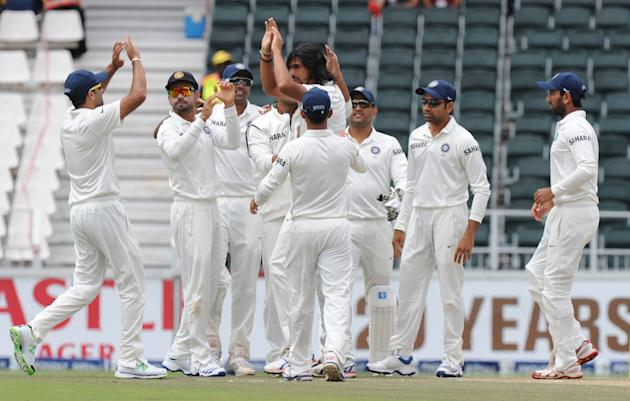 Indian bowler Ishant Sharma (C) is congratulated by teammates for Alviro Petersen's wicket on the second day of the first cricket Test match between South Africa and India at the Wanderers Stadium in