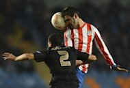 Atletico Madrid's forward Adrian Lopez (R) vies with Academica's defender Joao Dias during the UEFA Europa League football match A. Academica de Coimbra vs Club Atletico de Madrid at the Cidade de Coimbra stadium in Coimbra. Academica won 2-0