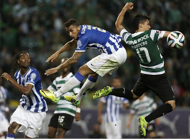 Sporting's Montero, from Colombia, right, and Porto's Danilo, from Brazil, jump for the ball during their Portuguese league soccer match Sunday, March 16, 2014, at Sporting's Alvalade stad
