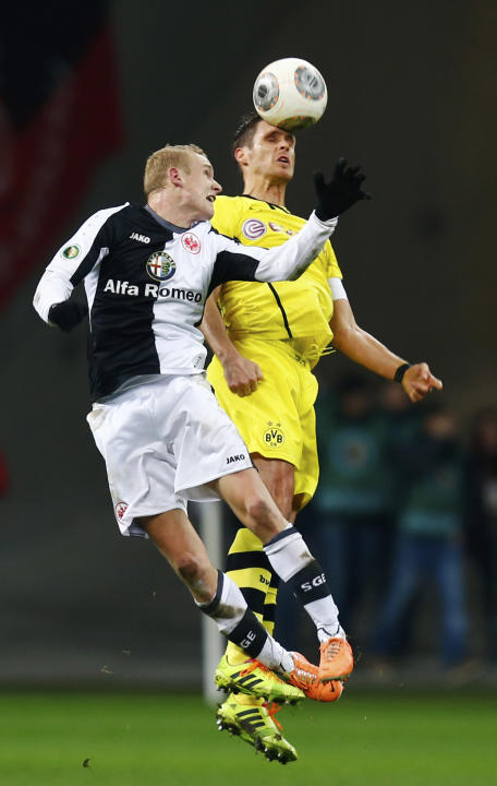 Eintracht Frankfurt's Rode challenges Borussia Dortmund's Kehl during their German soccer cup (DFB Pokal) quarter-final soccer match in Frankfurt