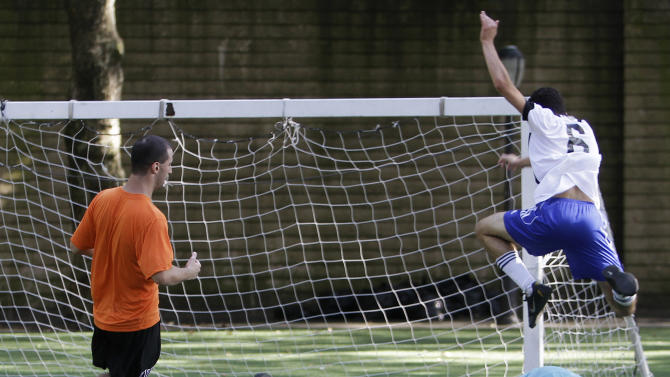 Holland's goalkeeper Ian Oldaker saves a goal during the New York City World Cup on Aug. 4, 2012 at Harlem's Riverside Park in Manhattan. The New York tournament, with 20 teams representing countries worldwide, gives more than 200 soccer enthusiasts a chance to play with an international scope without leaving the city. The Holland team won all their preliminary matches enroute to the finals. (AP Photo/Fay Abuelgasim)