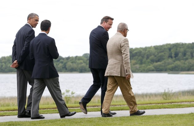 Libya's Prime Minister Ali Zeidan walks with Britain's Prime Minister David Cameron during the G8 summit at the Lough Erne golf resort in Enniskillen