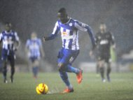 Sheffield Wednesday's Jermaine Johnson in action as heavy rain falls before the match is called off
