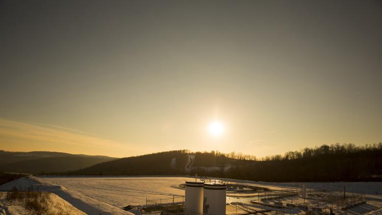 File photo of a Chesapeake Energy natural gas well pad resting on the hill in Litchfield Township