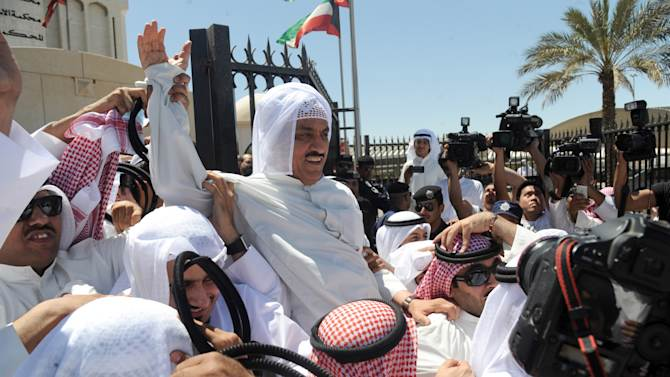 Former Kuwait's member of parliament Musallam al-Barrack is greeted by supporters outside the Justice Palace in Kuwait City on Monday, April 22, 2013. The court ruled that Barrak should be released on bail of 5,000 dinars ($17,600) and that his lawyers could argue his case next month. The opposition figure was sentenced to five years in jail last week for remarks made at a rally last year. (AP Photo/Gustavo Ferrari)