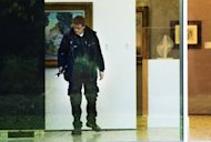 A investigator searches the Rotterdam Kunsthal museum for clues following the break-in. Seven masterpieces, including priceless works by Picasso, Matisse, Monet and Gauguin, were stolen in a night heist at Rotterdam&#39;s Kunsthal museum, police said Tuesday