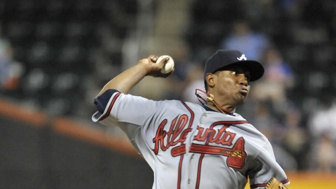 Atlanta Braves starting pitcher Julio Teheran throws against the New York Mets in the third inning of the second game of a baseball doubleheader on Thursday, Sept. 8, 2011, at Citi Field in New York. (AP Photo/Kathy Kmonicek)