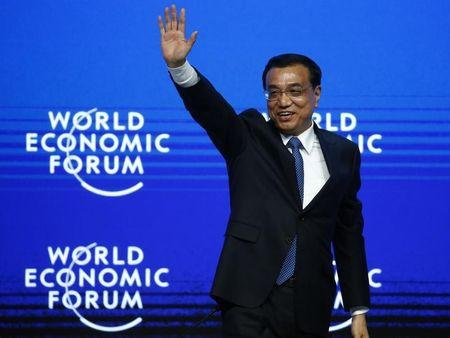 China's Premier Li waves to listeners after his speech during The Global Impact of China's Economic Transformation event in the Swiss mountain resort of Davos