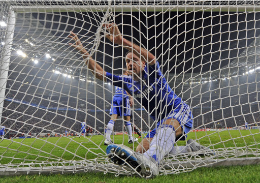 Chelsea's captain John Terry has fallen into the net after Leverkusen scored their side's first goal during the Champions League Group E soccer match between Bayer Leverkusen and Chelsea FC in Leverkusen, Germany, Wednesday, Nov. 23, 2011. Leverkusen defeated Chelsea with 2-1. (AP Photo/Martin Meissner)