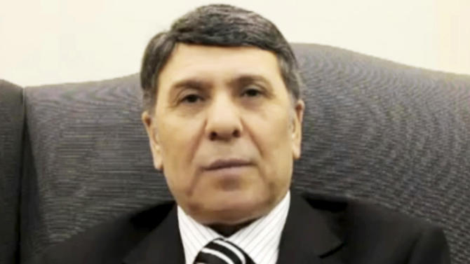 This image made from amateur video and released by Aljizahnews Thursday, March 8, 2012, purports to show a deputy to Syria's oil ministry who identifies himself as Abdo Husameddine at an unidentified location. A man purporting to be Syria's deputy oil minister has announced his defection in an online video that emerged Thursday, saying he is joining the opposition against President Bashar Assad's regime to protest its brutal crackdown that has killed thousands so far. (AP Photo/Aljizahnews via APTN) THE ASSOCIATED PRESS CANNOT INDEPENDENTLY VERIFY THE CONTENT, DATE, LOCATION OR AUTHENTICITY OF THIS MATERIAL. TV OUT