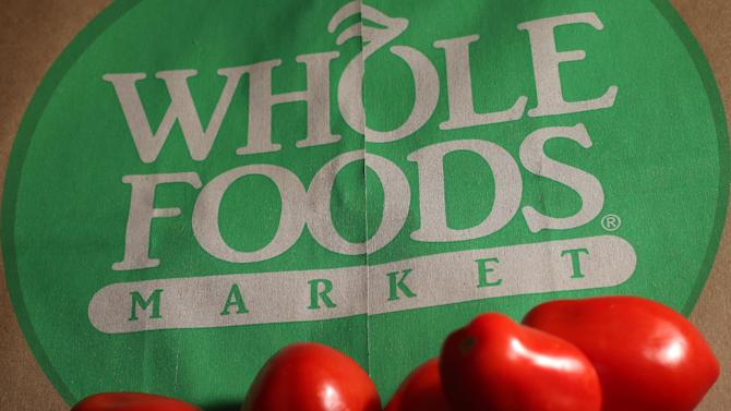 FILE - This July 29, 2013 file photo shows produce on a Whole Foods paper bag in Andover, Mass. Whole Foods Market Inc. said bad weather in 2014 has shoppers making fewer trips to its stores, hurting sales growth. (AP Photo/Elise Amendola, File)