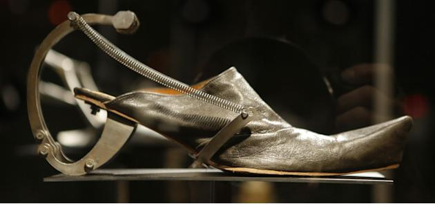 "This Feb. 11, 2013 photo shows Kei Kagami's oxidized metal and leather footwear on display at the ""Shoe Obsession"" exhibit at The Museum at the Fashion Institute of Technology Museum in New York. The"