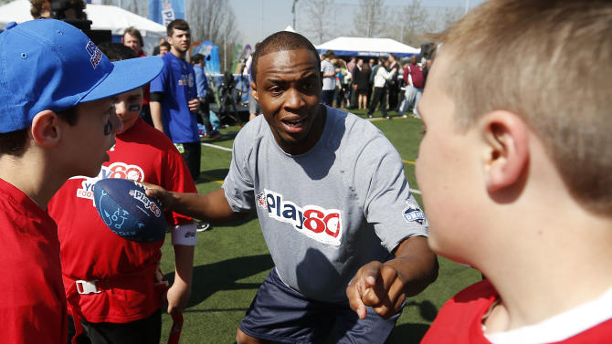 IMAGE DISTRIBUTED FOR NFL NETWORK - NFL Draft prospect Tavon Austin, of West Virginia, huddles up with young football players during the NFL Play 60 Youth Football Festival, Wednesday, April 24, 2013 in New York. (Jason DeCrow/AP Images for NFL Network)