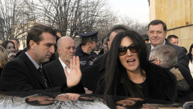 Italian actress Monica Bellucci waves to supporters during a visit to the Bosnian town of Banja Luka, 240 kms northwest of Sarajevo, Bosnia, on Saturday, Jan. 19, 2013. (AP Photo/Radivoje Pavicic )