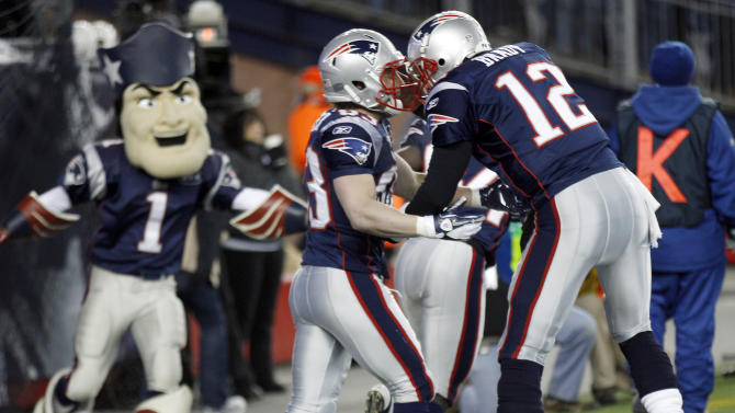 New England Patriots quarterback Tom Brady (12) congratulates New England Patriots wide receiver Wes Welker after Welker scored on a seven yard touchdown pass during the first half of an NFL divisional playoff football game against the Denver Broncos Saturday, Jan. 14, 2012, in Foxborough, Mass. (AP Photo/Charles Krupa)