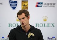 US Open champion Andy Murray of Britain attends a press conference at the Shanghai Masters tennis tournament in Shanghai. History-making Kei Nishikori was dumped out of the Shanghai Masters as Novak Djokovic cruised into the third round and Murray was handed a walkover